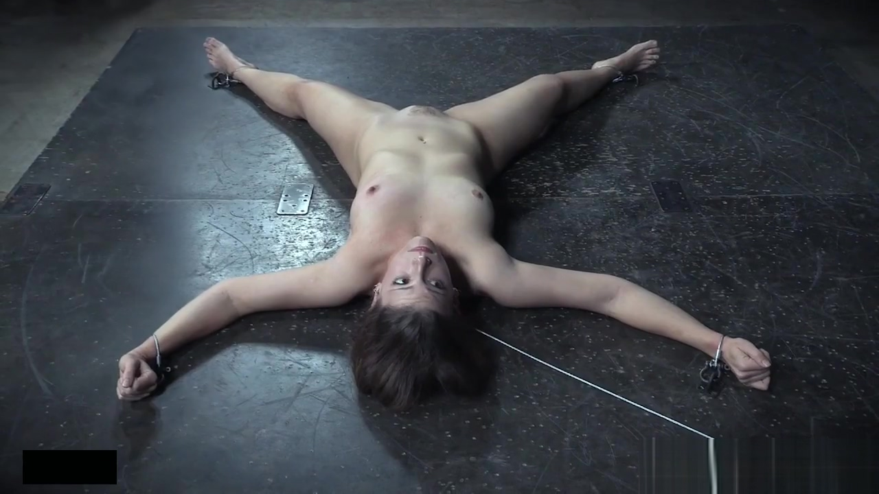 Cuffed slave gets whipped before pussy toyed