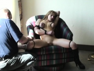 Blonde busty babe gets big boobs bonded in chair
