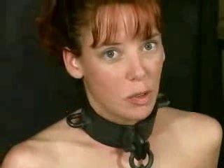 Hot slave girl with cute face dominated in dungeon