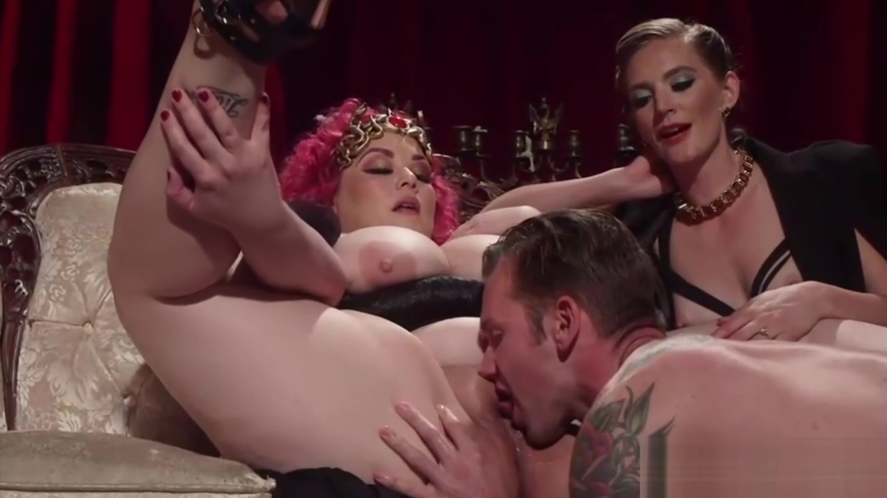 Two kinky dominas playing with their slave boy